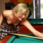 Looking down the blonde girls top as she plays pool
